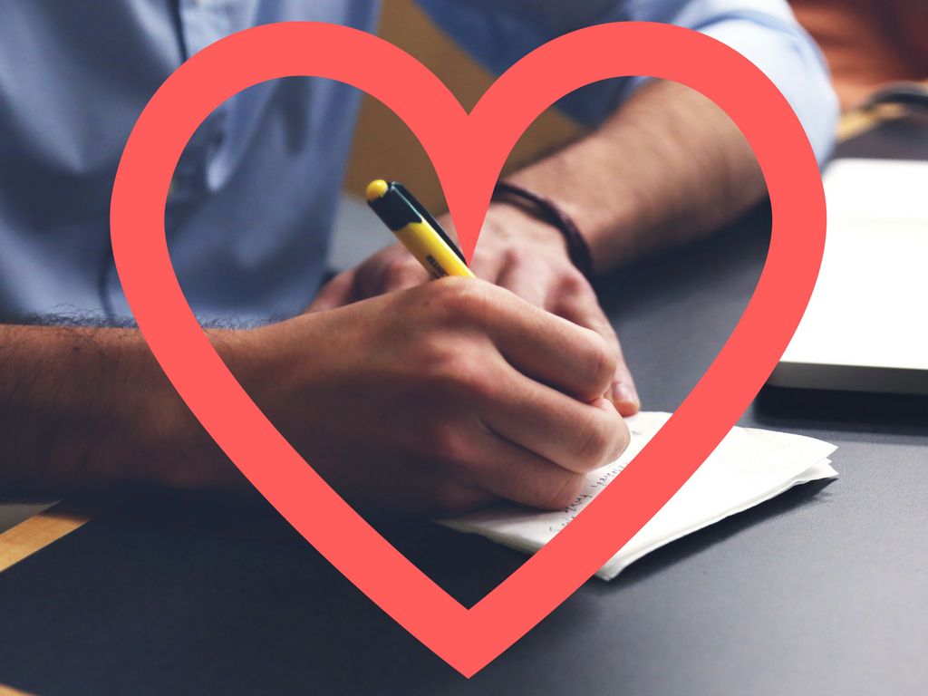 Four communication tips to win the hearts of your consumers a photo of a person writing with a heart overlaid