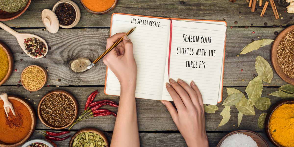 "Photo of a woman's hand writing in a notebook on a table filled with seasonings. The notebook says, ""The secret recipe: season your writing with the three P's"""