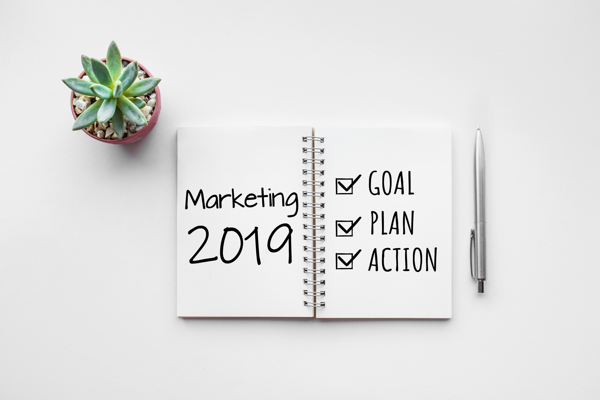 Image of a notebook with 2019 marketing plans
