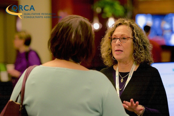 Laurie Tema-Lyn talking with a QRCA attendee